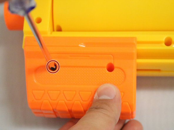 Image 1/2: Locate the screws on the orange pump and proceed to take them out.