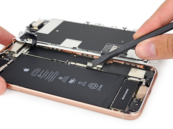 The battery connector is no match against our trusty spudger. Just like we saw  in the iPhone 8,  Apple ditched the tricky tri-points we're accustomed to seeing on this bracket and replaced them with Phillips #000 screws.