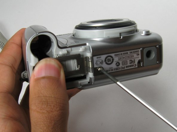 Remove the six 4 mm phillips head screws that are found on both the sides and bottom of the camera with the Phillips #00 Precision Screwdriver.