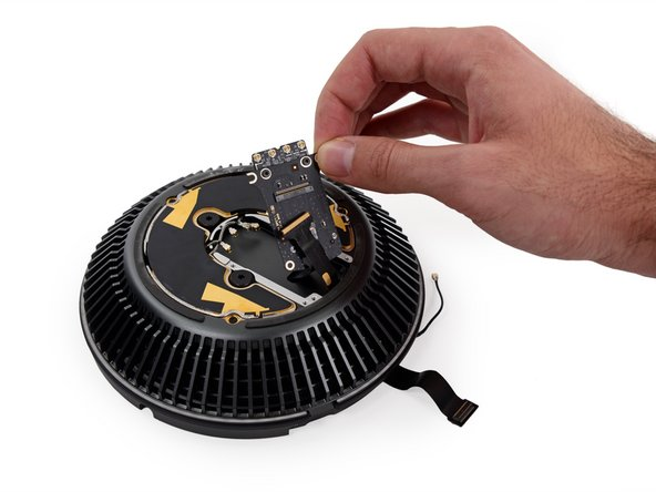 Those three large screws secure the fan, with vibration-dampening rubber bumpers, like we've seen in iMacs.