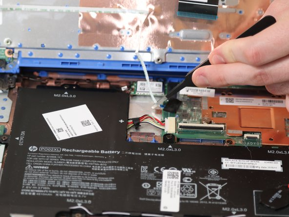 Use tweezers to disconnect both ribbon cables and the ZIF connector.