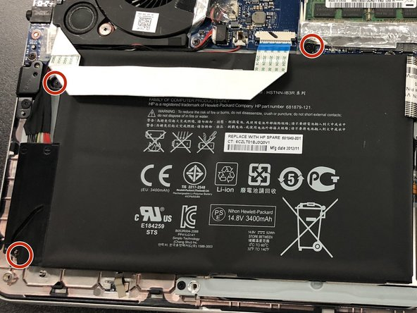 Remove the three Phillips #0 screws from the battery.
