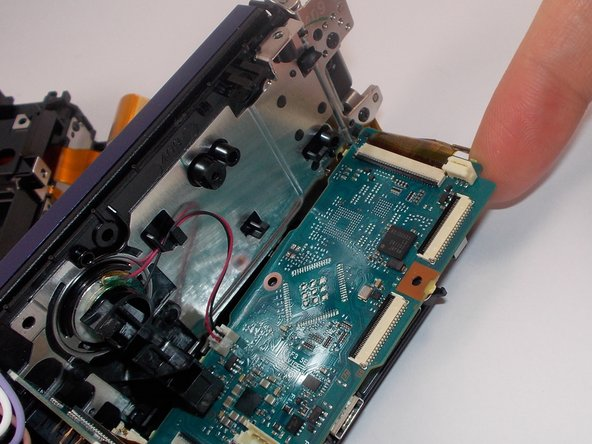 Image 2/2: Gently remove the motherboard with your fingers.