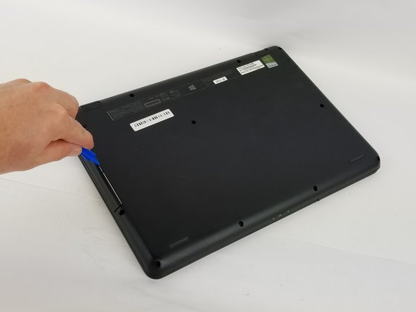 Insert the plastic opening tool into the slit of the  CD drive.