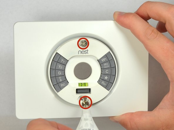 Remove the two 40mm screws from the base of the thermostat using a #0 Phillips screw driver.