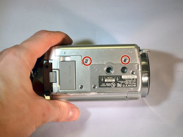 Turn device onto it's top with the lens facing right.