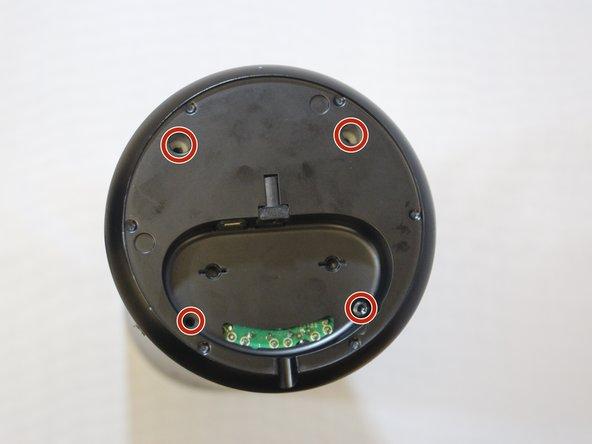 Use a #10 Torx screwdriver to remove four 14 mm screws.