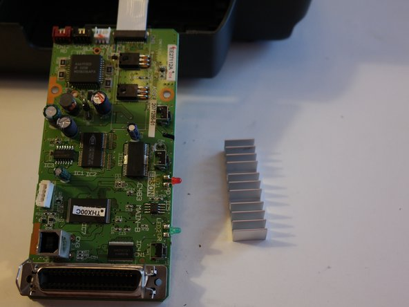 Image 2/3: The large dual ribbon cable for the printhead attaches to two connectors on the logic board, one on each side.