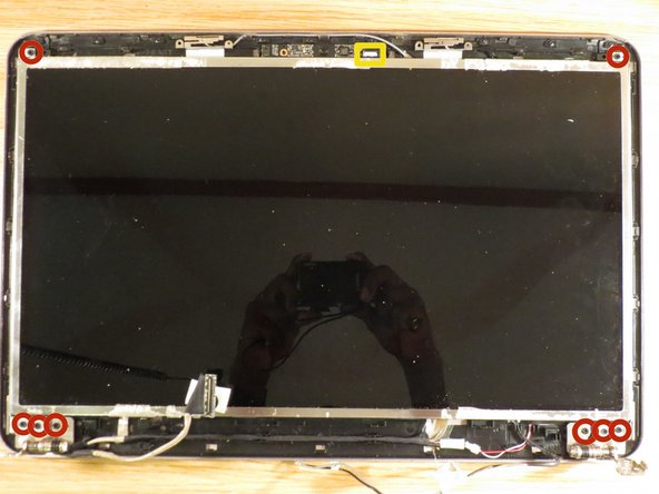 Remove the eight screws holding the LCD panel.