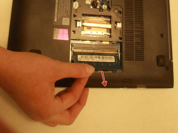 After hearing a click sound, pull the RAM out from the brackets.