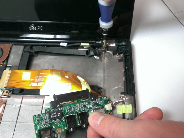 Using the Phillips #00 screwdriver, unscrew the 4mm screws attaching screen to base from both sides.