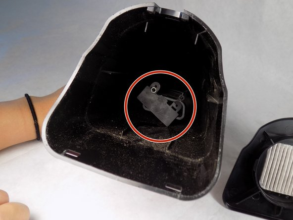Remove the nose of the vacuum and gently pull off the rubber seal by hand.