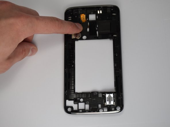 The home button cable is attached to both the front and the back  of the outer frame with adhesive. Orient the frame so that where the screen would be is facing you. Peel back the black rubber tab covering the wire.