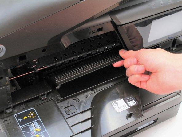 Lift the door-hinge guide upward and away from the front panel door.