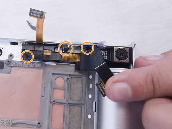 Remove the three 2mm screws on the back of the right speaker module with the Phillips Screwdriver #00 bit.
