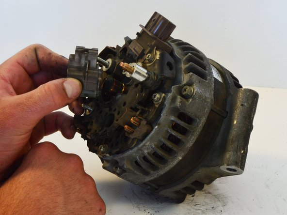 Remove the brush cover from the alternator