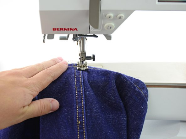 Sew along the edge of the hem for about a dozen stitches.