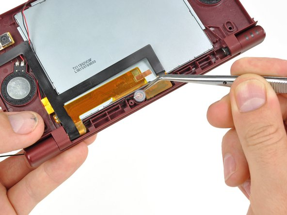 Close the DSi XL and turn it over.