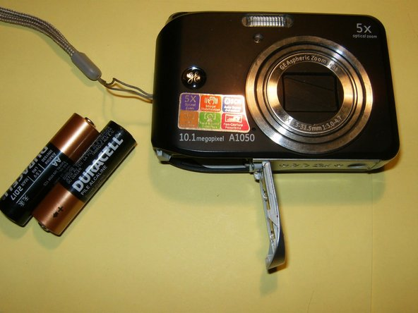Remove the batteries, hand strap, and memory card if so equipped.
