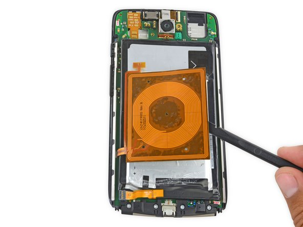 Fold the wireless charging coil away from the battery.