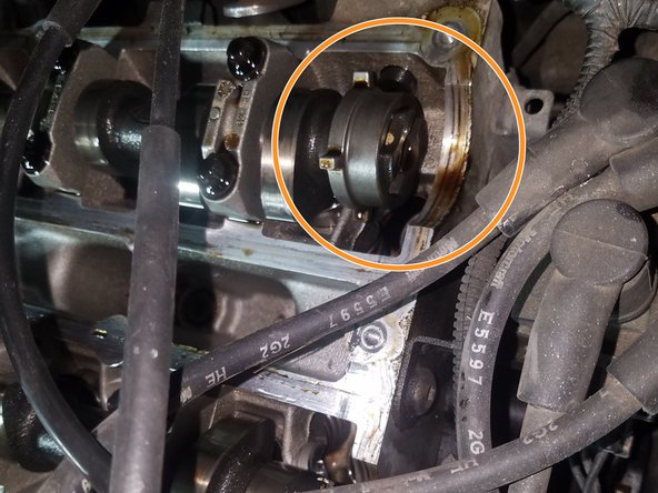 You may want to rest a wooden dowel in the spark plug hole of piston #1 to observe its movement