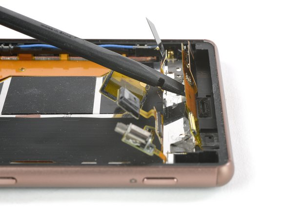 Use a spudger to gently slide beneath the display flex cable and lift it up.