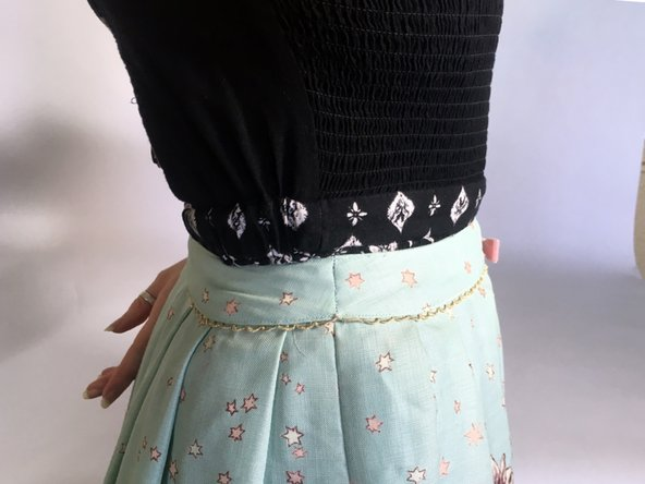 Stitch both waistbands together, following the side seam from the outside.