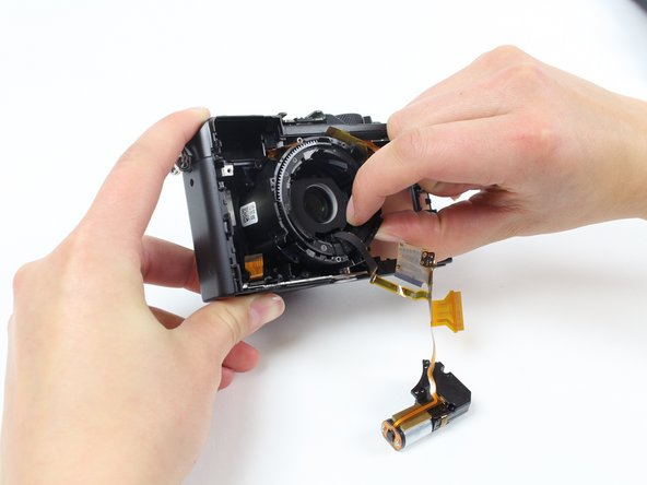 With two fingers, pinch the edge of the lens and gently pull it out.