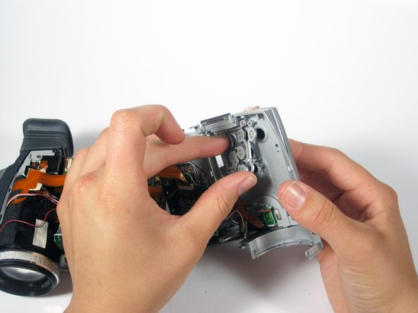 Pull the button pad out of its chassis.