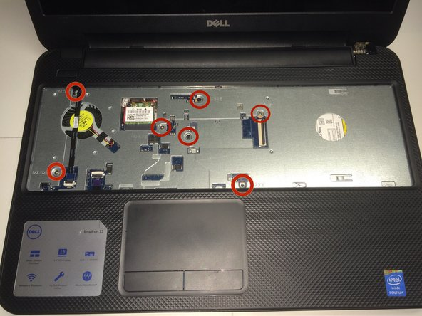 Remove the four 2.5 mm by 5 mm screws underneath the keyboard plate using a phillips head PH0 screwdriver.