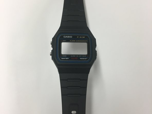 Press your fingers on the screen and remove the watch from its case.