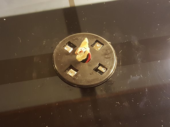 Image 3/3: Gently rotate the plastic spudger around the disk to get around the adhesive