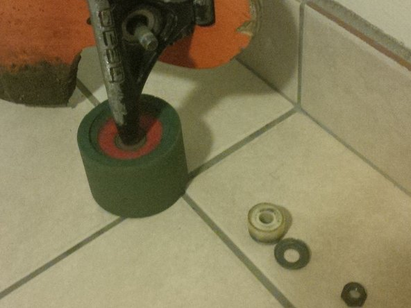 Pull off the white rubber bushing and set it down next to the washer.