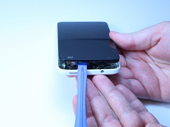 Using a plastic opening took, work your way around the phone to gently separate the case from the phone