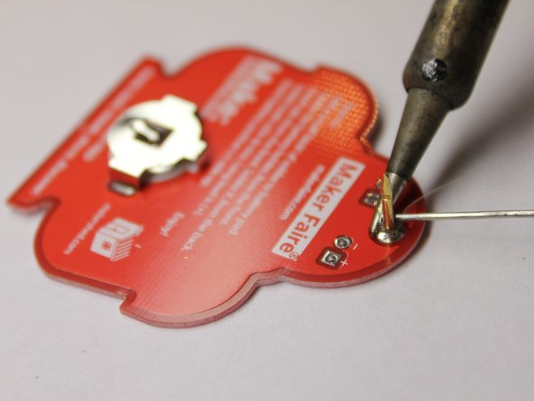 The material in this junction is sufficiently greater in mass than the battery holder, thus it will require more heat to raise it to the correct temperature. Leave the iron in place a little longer than previously, and check how well solder flows when you begin.