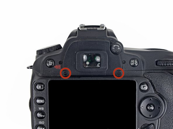 Using a PH000 screwdriver, remove the two 4.8mm Phillips screws from the back of the viewfinder.