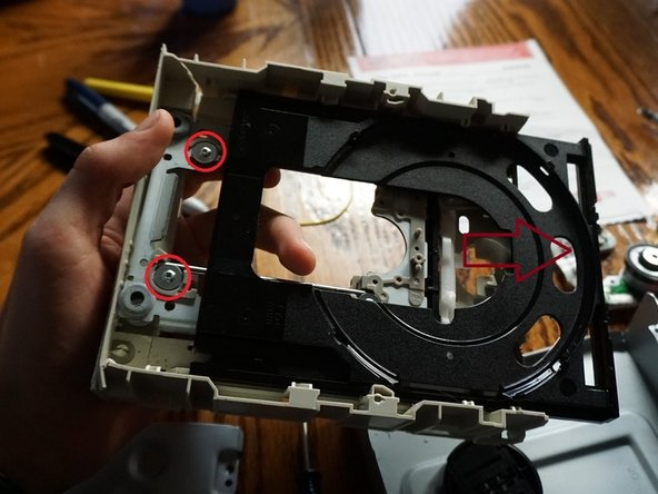 flip the leftovers over and slide the peice of black plastic far forward to remove the screws holding the metal in place