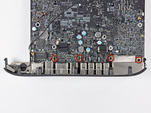 Remove the four 2.6 mm T6 Torx screws securing the I/O bezel to the logic board.