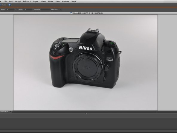 Here is a bare bones photo of a Nikon D70 camera. The picture is pretty good, but could be improved in a few areas.