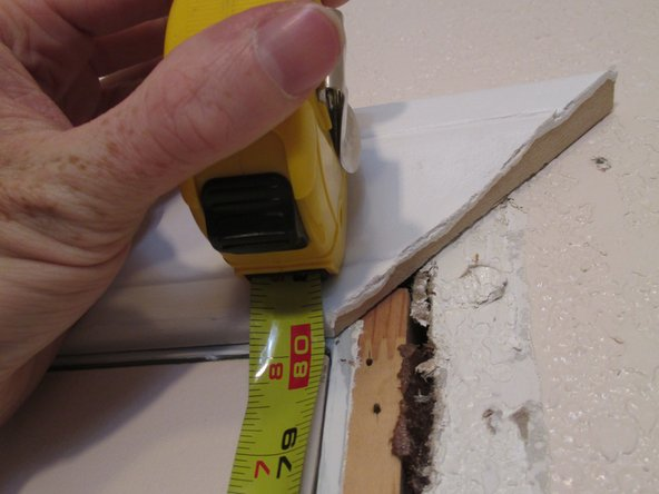 Image 1/2: Measure along the inside of the door frame, from floor to corner.
