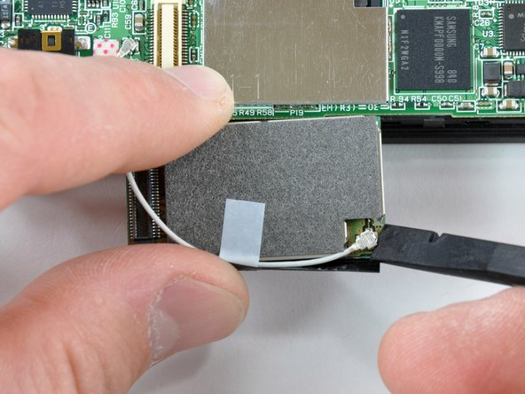 Another flick of the spudger removes the Wi-Fi board's connector wire.