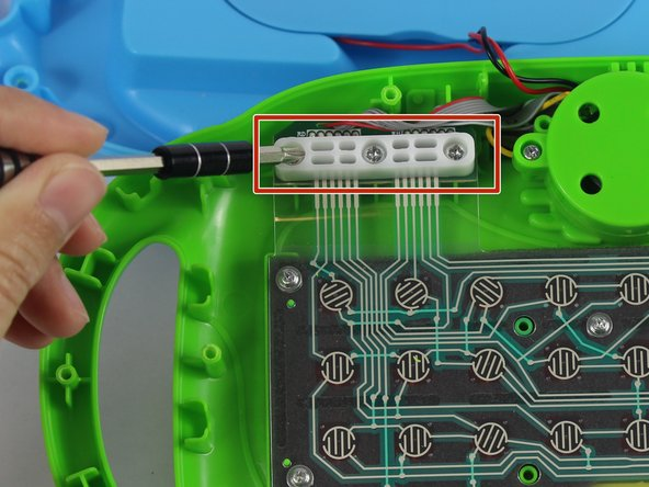 Remove the three 10mm screws from the upper left hand corner white plastic piece with a PH1 phillips head screwdriver.