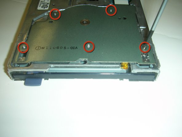 After you have removed the floppy drive core from its casing, unscrew these five screws shown.