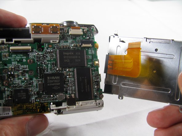 Image 3/3: Remove the LCD from the rest of the camera.