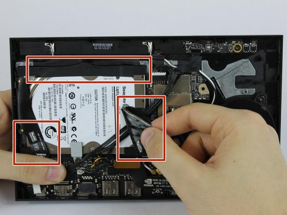 Remove the tape that is covering the hard drive.