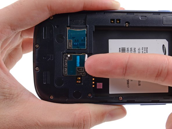 Using your fingernail, push the SIM card slightly deeper into its slot, until you hear a click.
