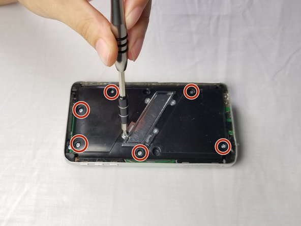 Using the PH0 screw driver, remove the 7.5 mm screws by turning in  a clockwise direction. There are 6 screws on the front panel.