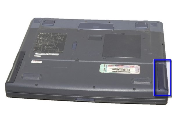 The battery is located on the front right side of the laptop; the opposite side from the floppy disk drive.