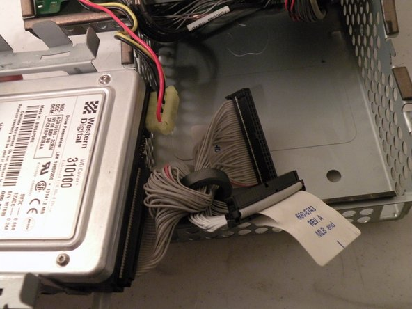 Make sure that no cables are snagged before completed pulling out the drive!