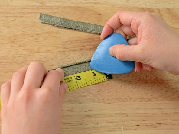 Measure one inch beyond where you just marked and make a second mark with tailor's chalk.